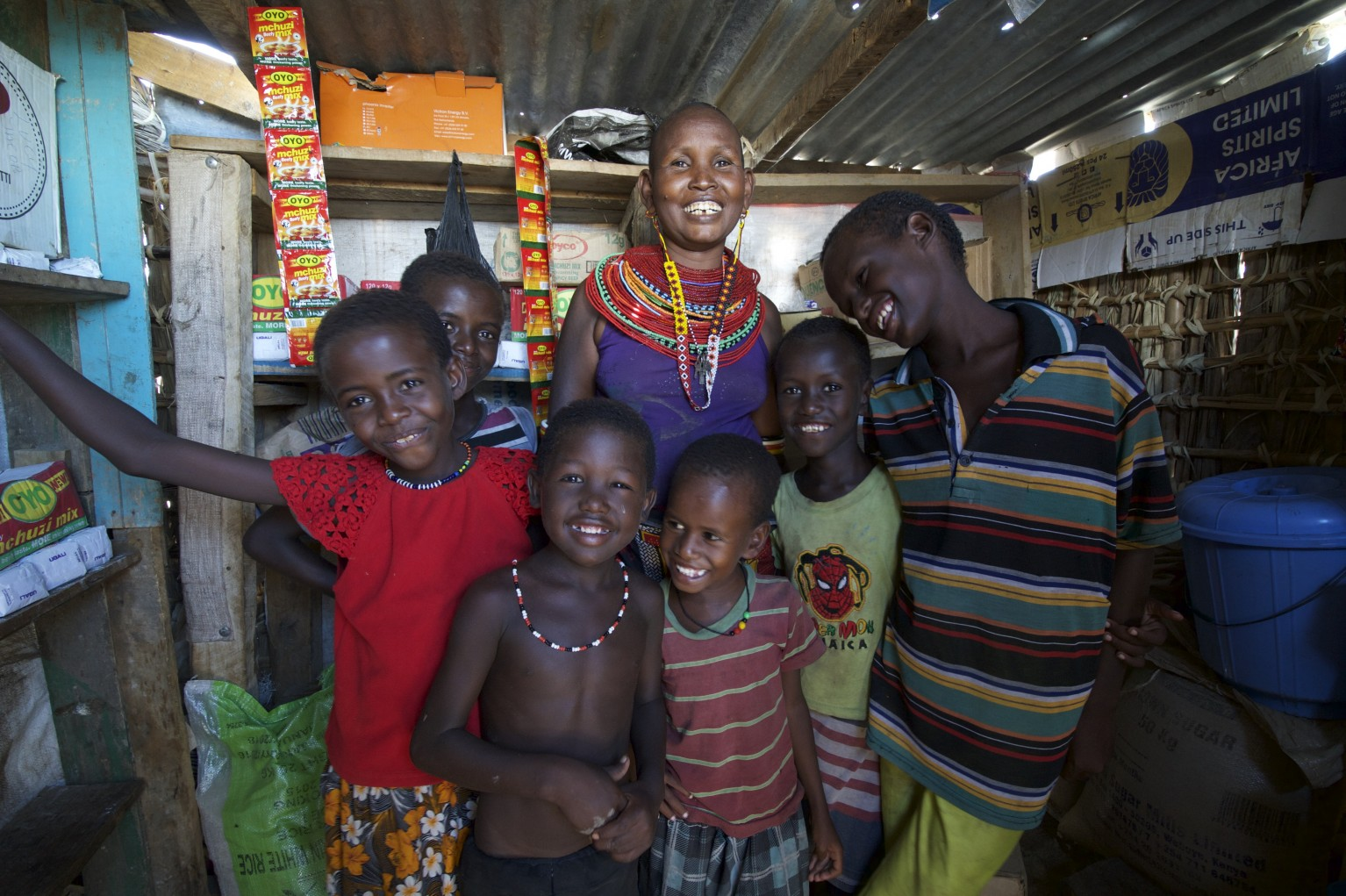 Choro Lemuson pictured with 6 of her 7 children in her shop in El-Molo